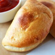 These Mini Calzones are stuffed with meaty cheesy Italian goodness! So crusty.
